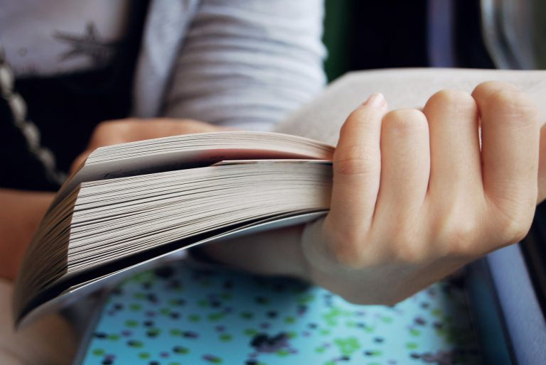 Girl,Holding,A,Book,In,Her,Hands,And,Reading.